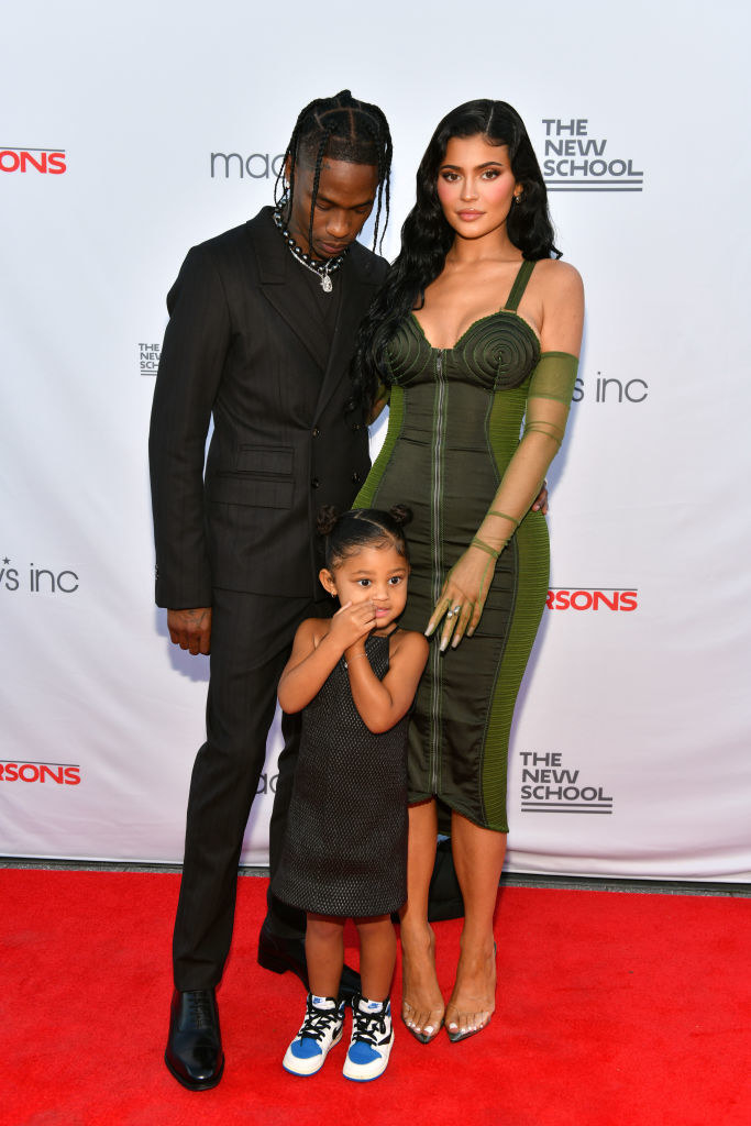 Travis Scott, Kylie Jenner, and their child on a red carpet