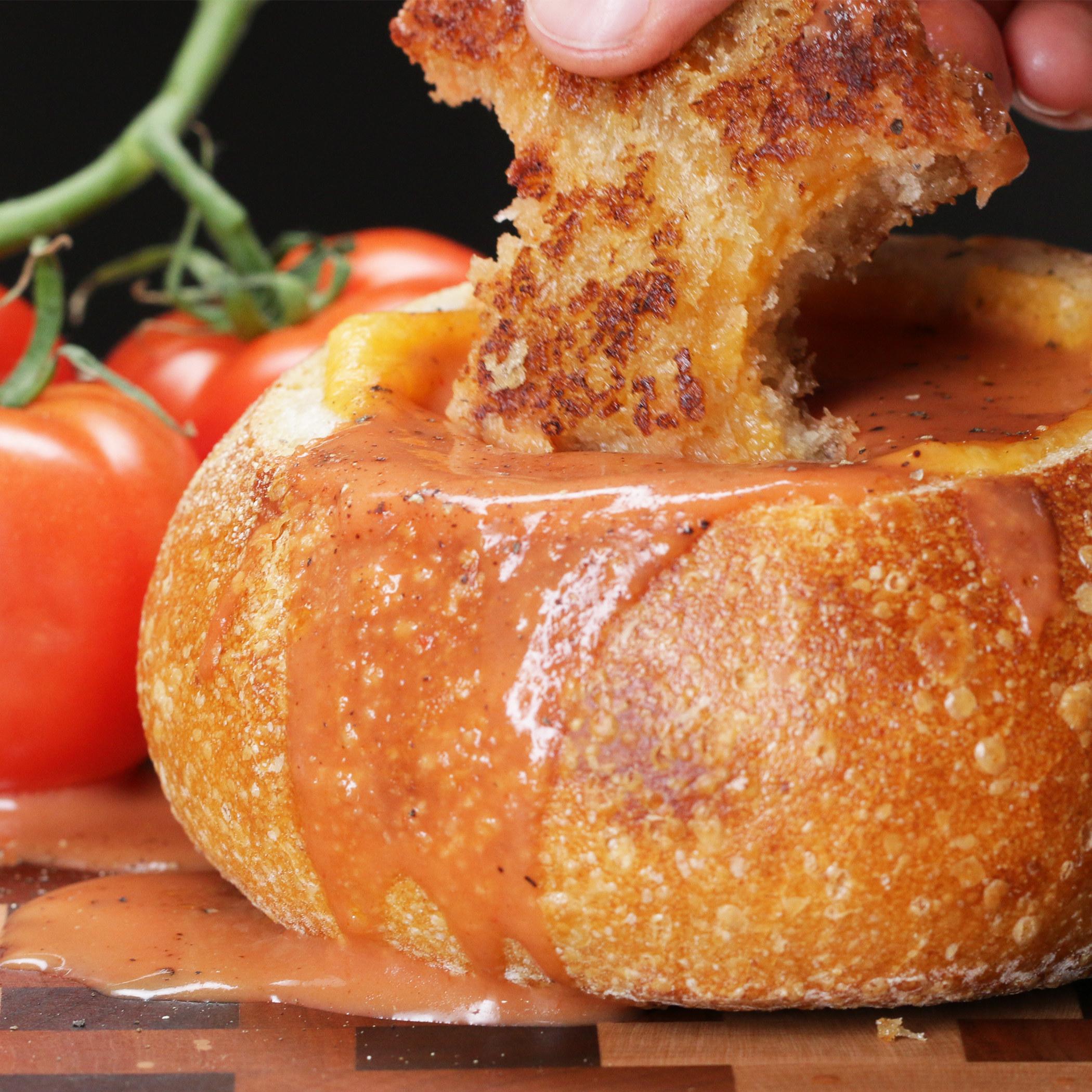 Bread bowl full of tomato soup