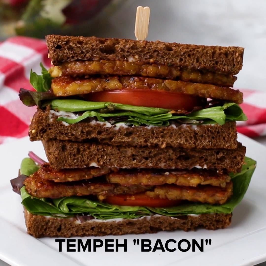 Sandwich with tempeh and veggies inside