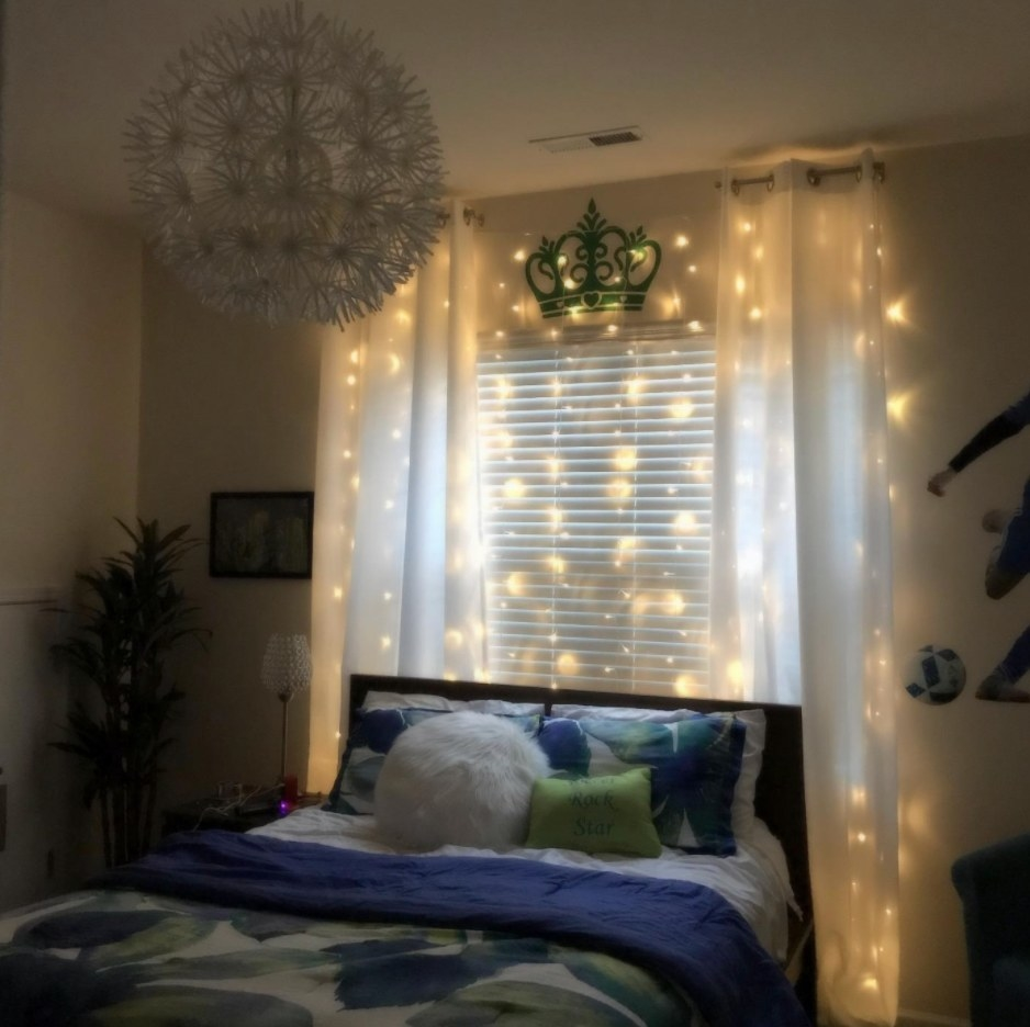 Twinkle Lights Behind a reviewer's Bed