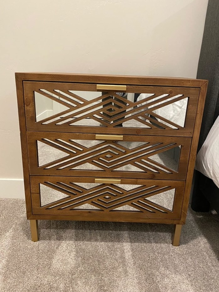 The wood and mirror chest
