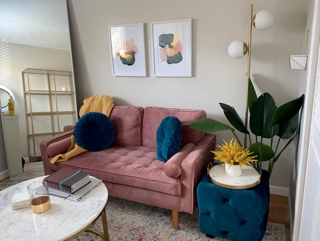 The gold globe floor lamp in a reviewer's home