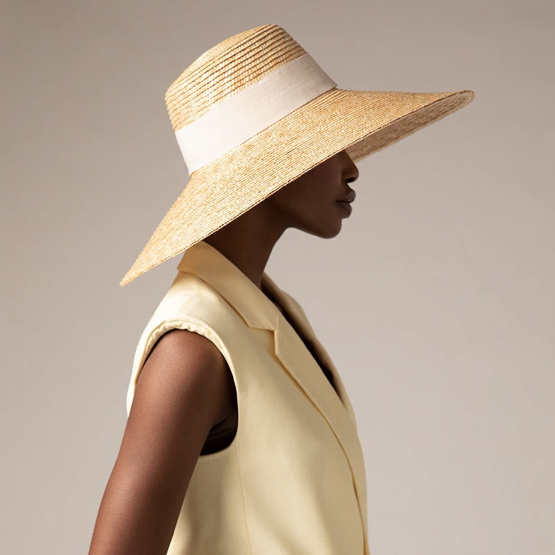 A person wearing a large sun hat