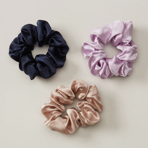 Three small scrunchies in a pile