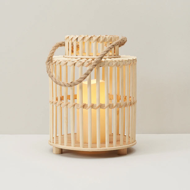 A small lantern with a candle inside
