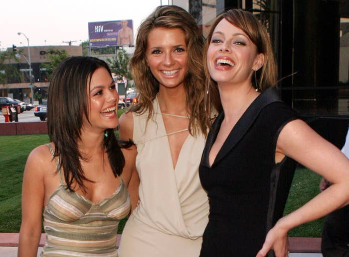 Melinda and Rachel laugh while Mischa smiles at an event