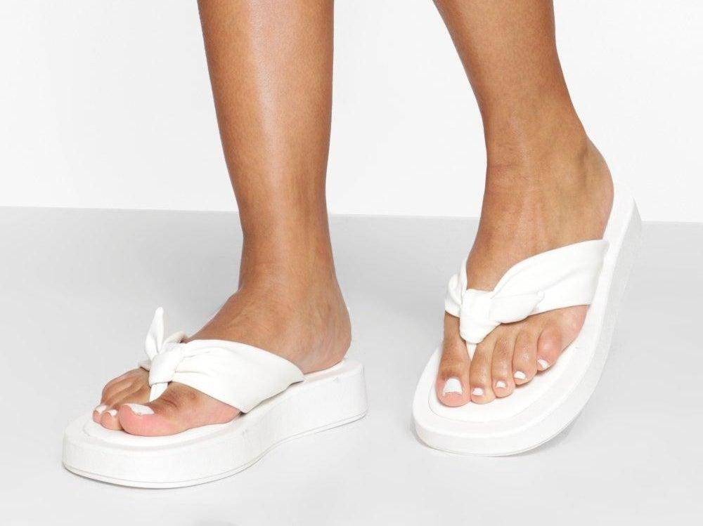 Model wearing white Chunky Toe Post Sporty Flip Flops