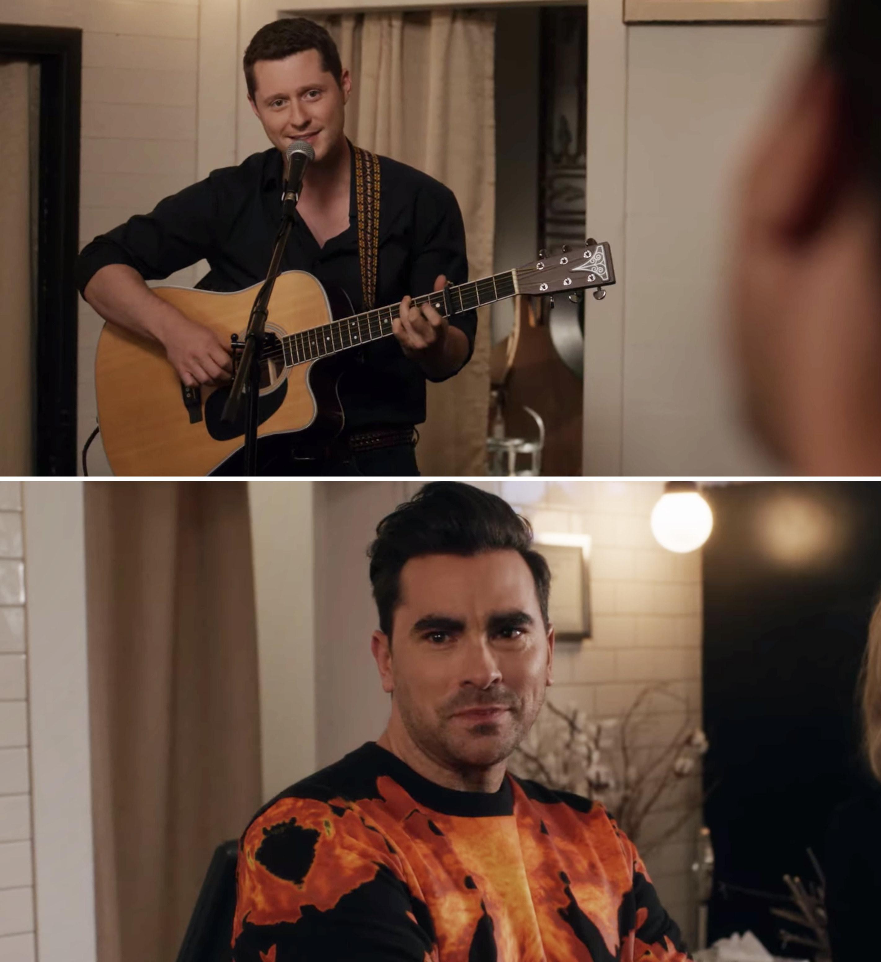 Patrick playing the guitar and David looking at him