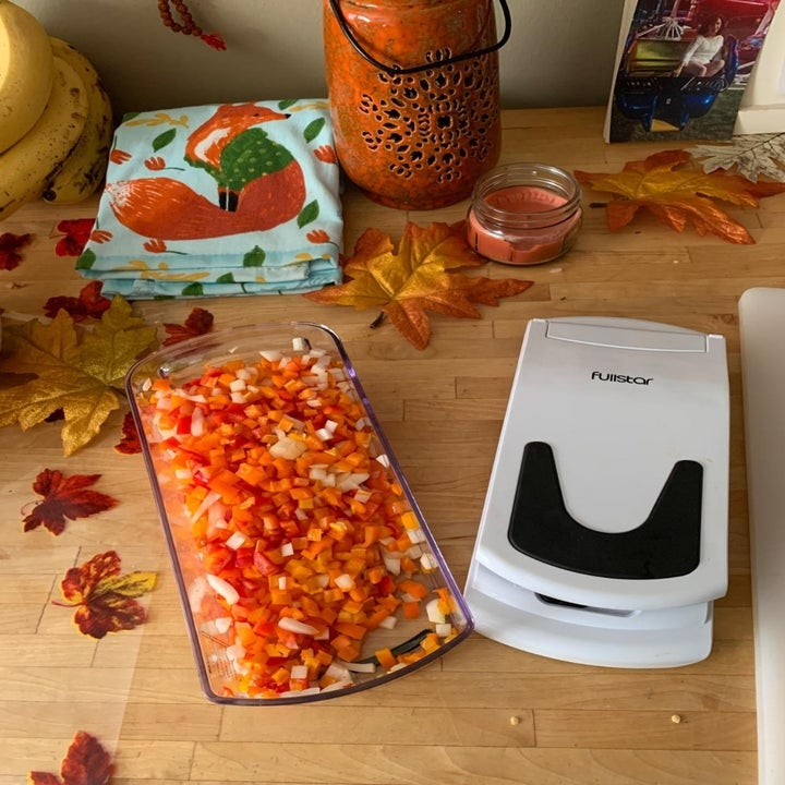 Reviewer's photo of carrots after slicing, plus the closed veggie slicer