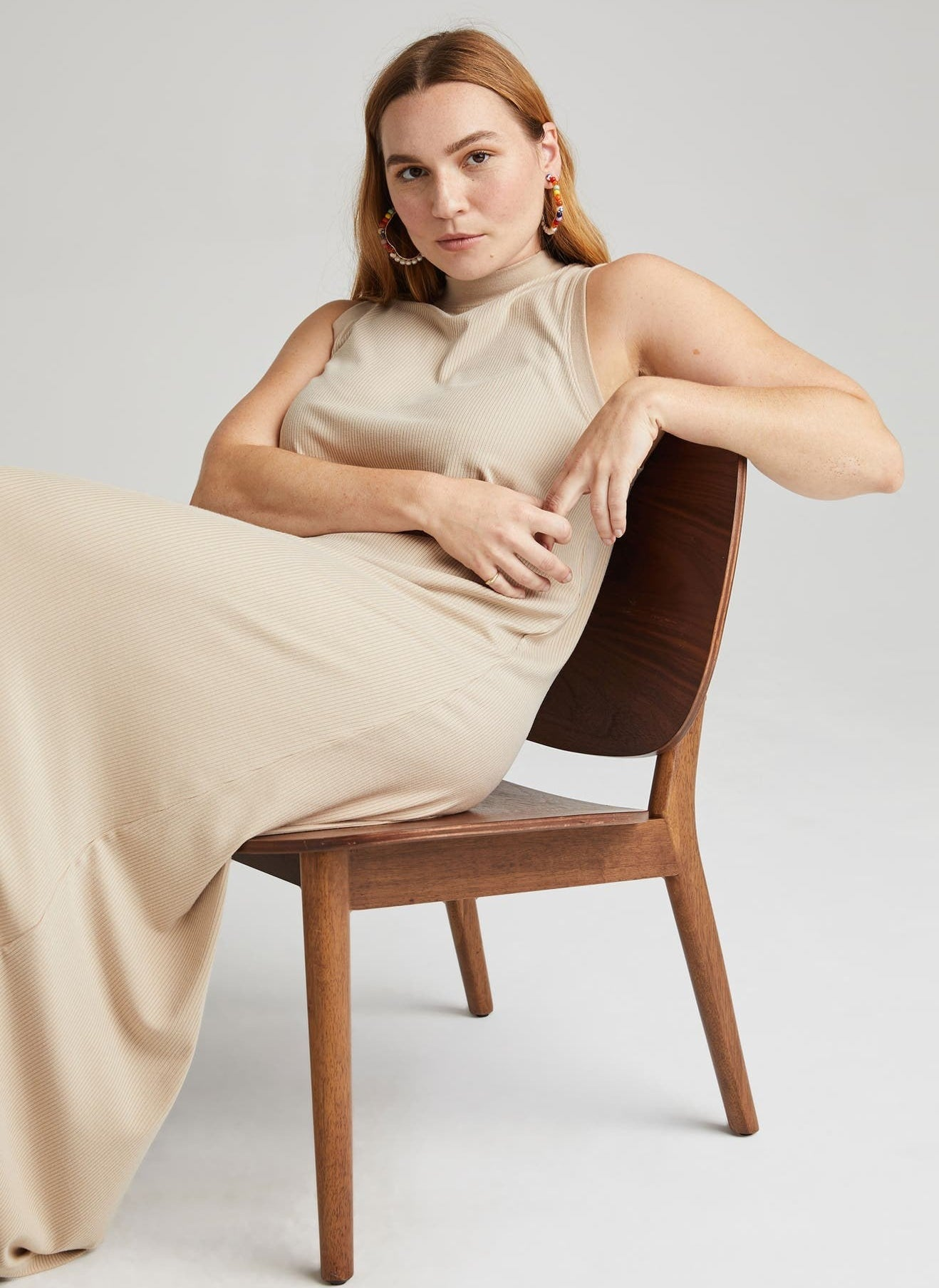 model wearing the taupe dress