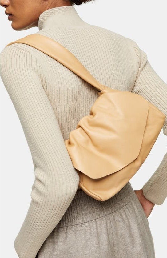 model carrying the ruched bag
