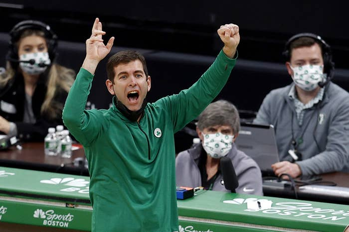 Brad Stevens coaching with his arms raised while yelling