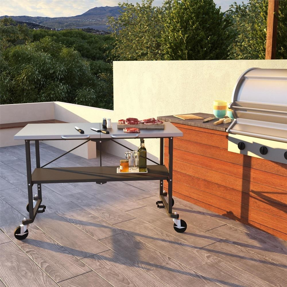 the grill table with two shelves and on four wheels