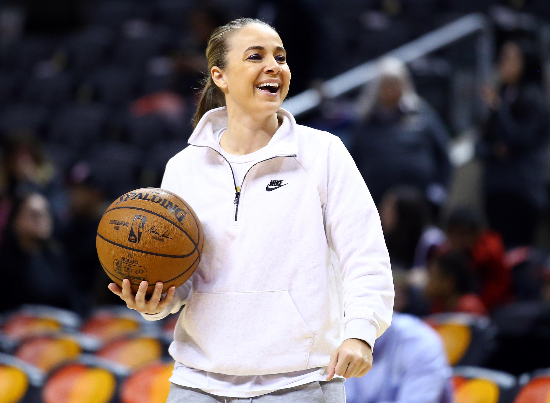 Becky Hammon with a basketball