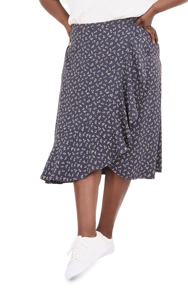 model wearing floral wrap skirt