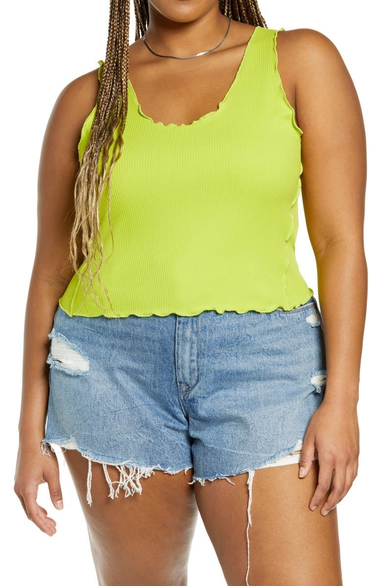 model wearing green top