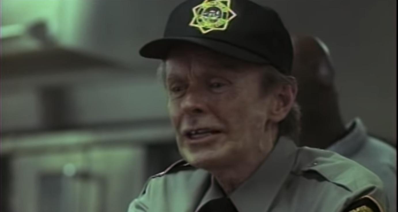 Hubert Selby Jr. as a racist prison guard