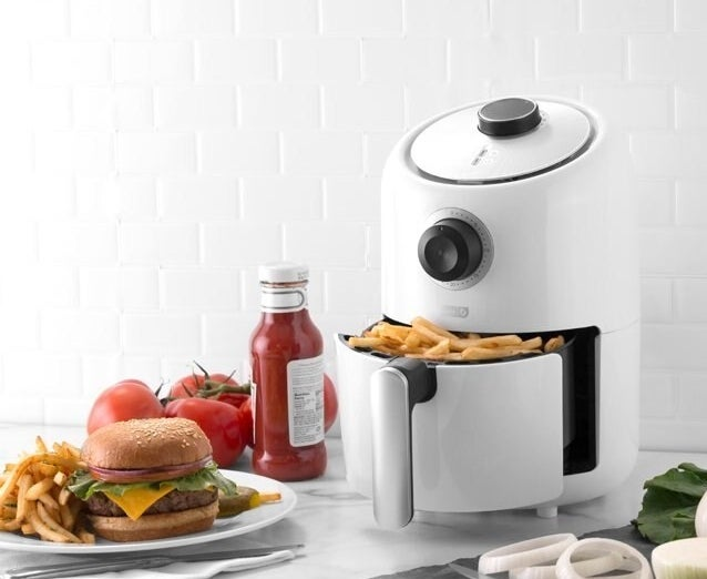 A mini air fryer on a kitchen counter