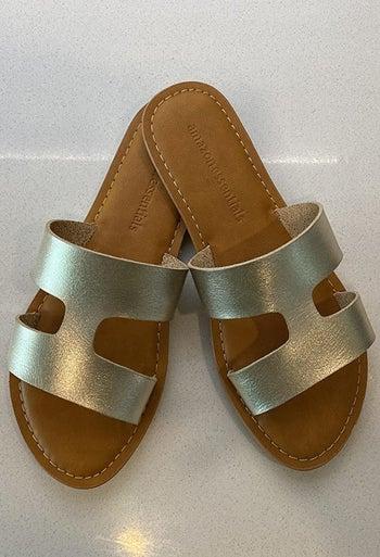 a reviewer's gold sandals