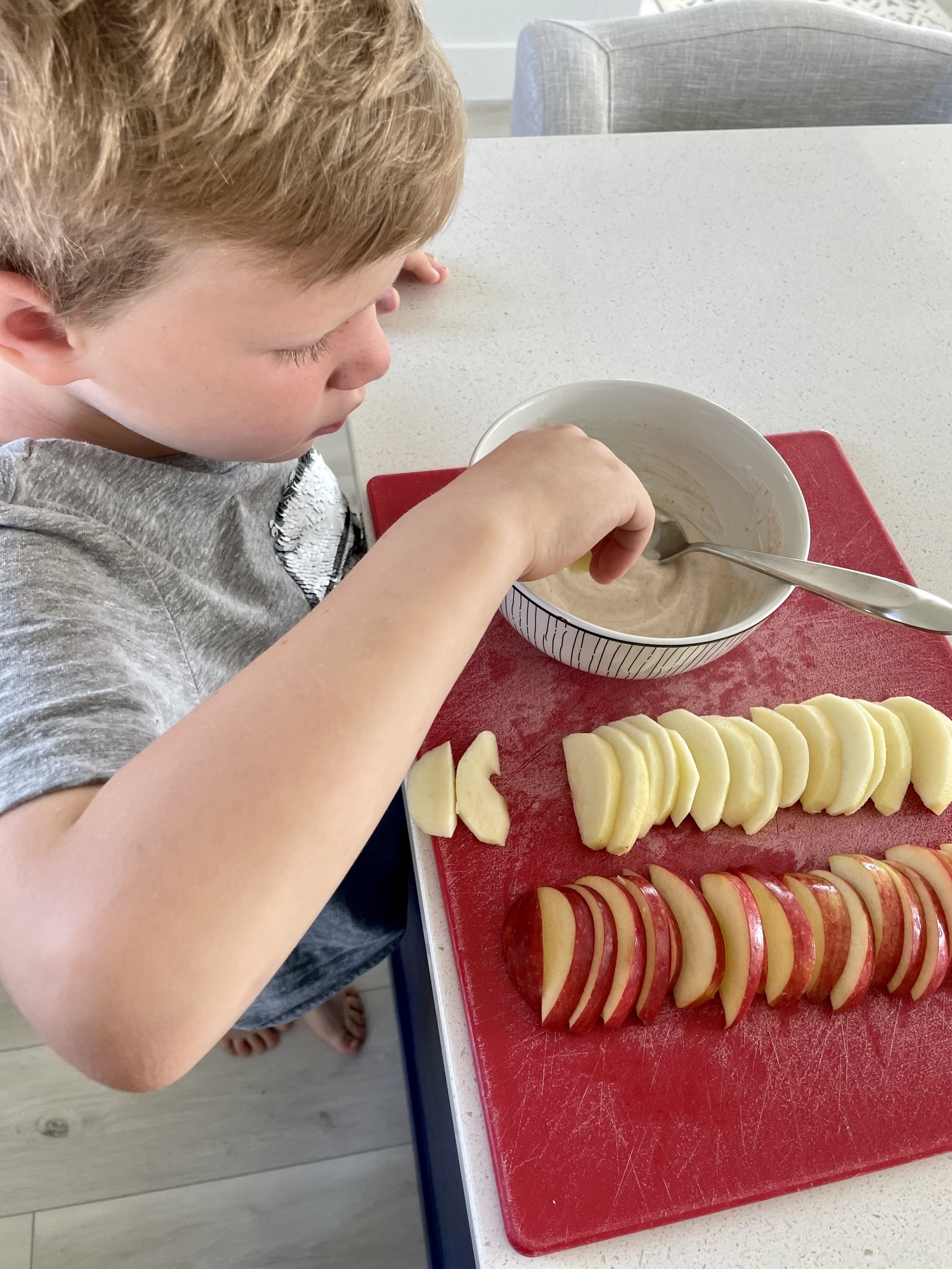 The author's oldest kid enjoying apple dippers