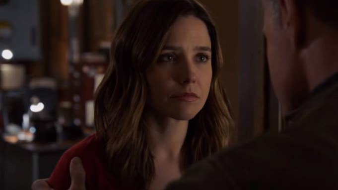Erin Lindsay (Sophia Bush) looks concerned, making eye contact with a man off-screen.