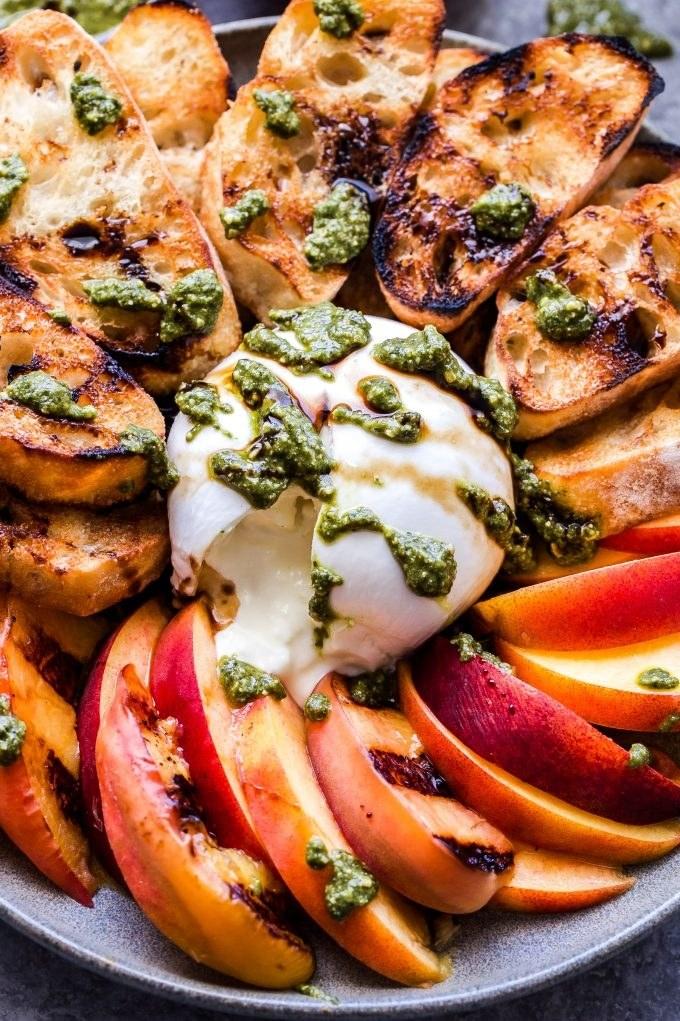Grilled peaches and burrata crostini with pesto