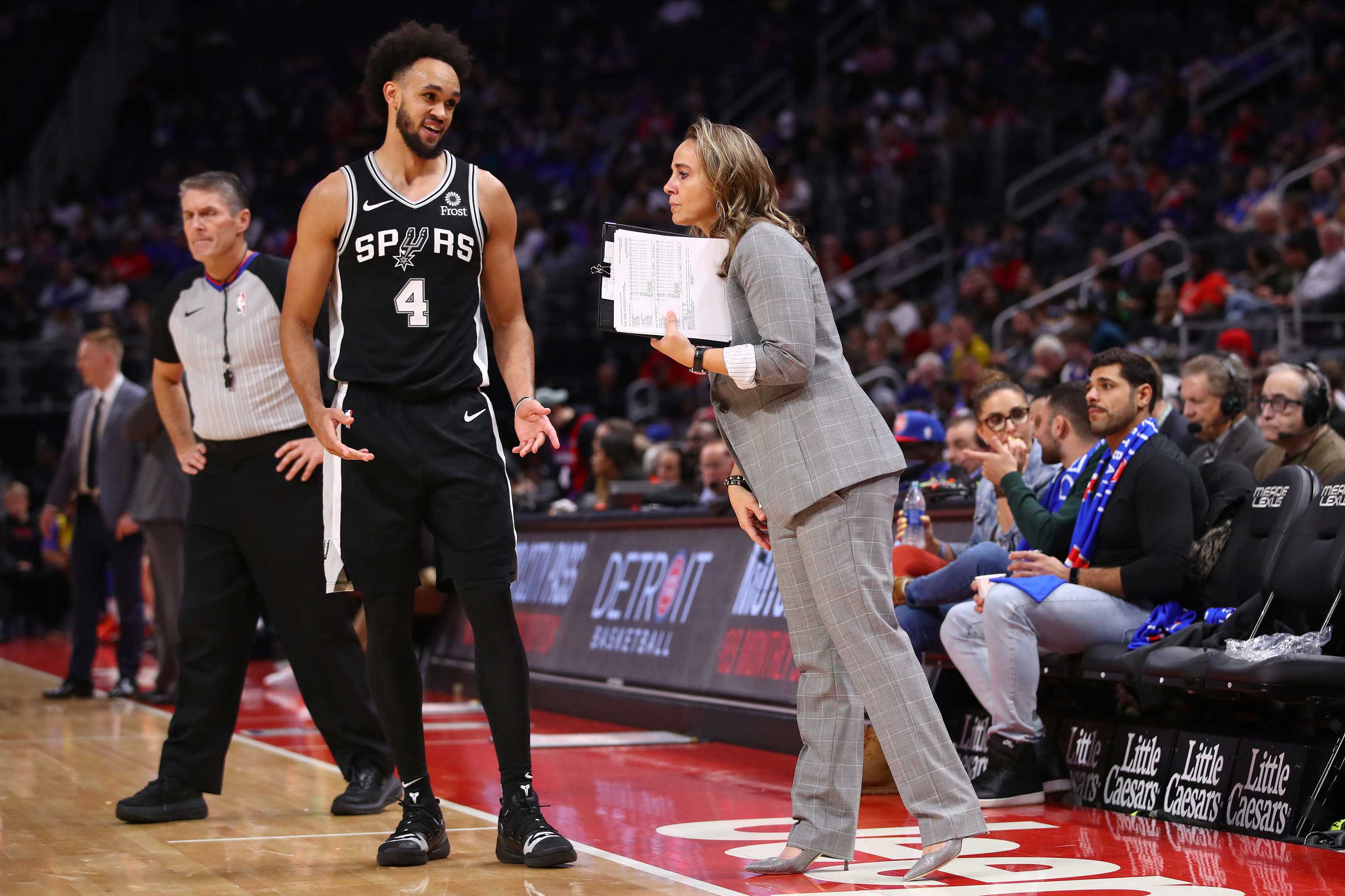 Becky Hammon with clipboard coaching