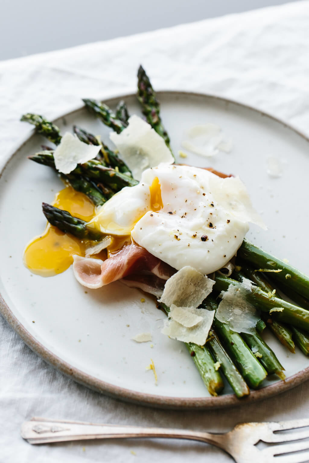 Grilled asparagus topped with prosciutto and a poached egg.
