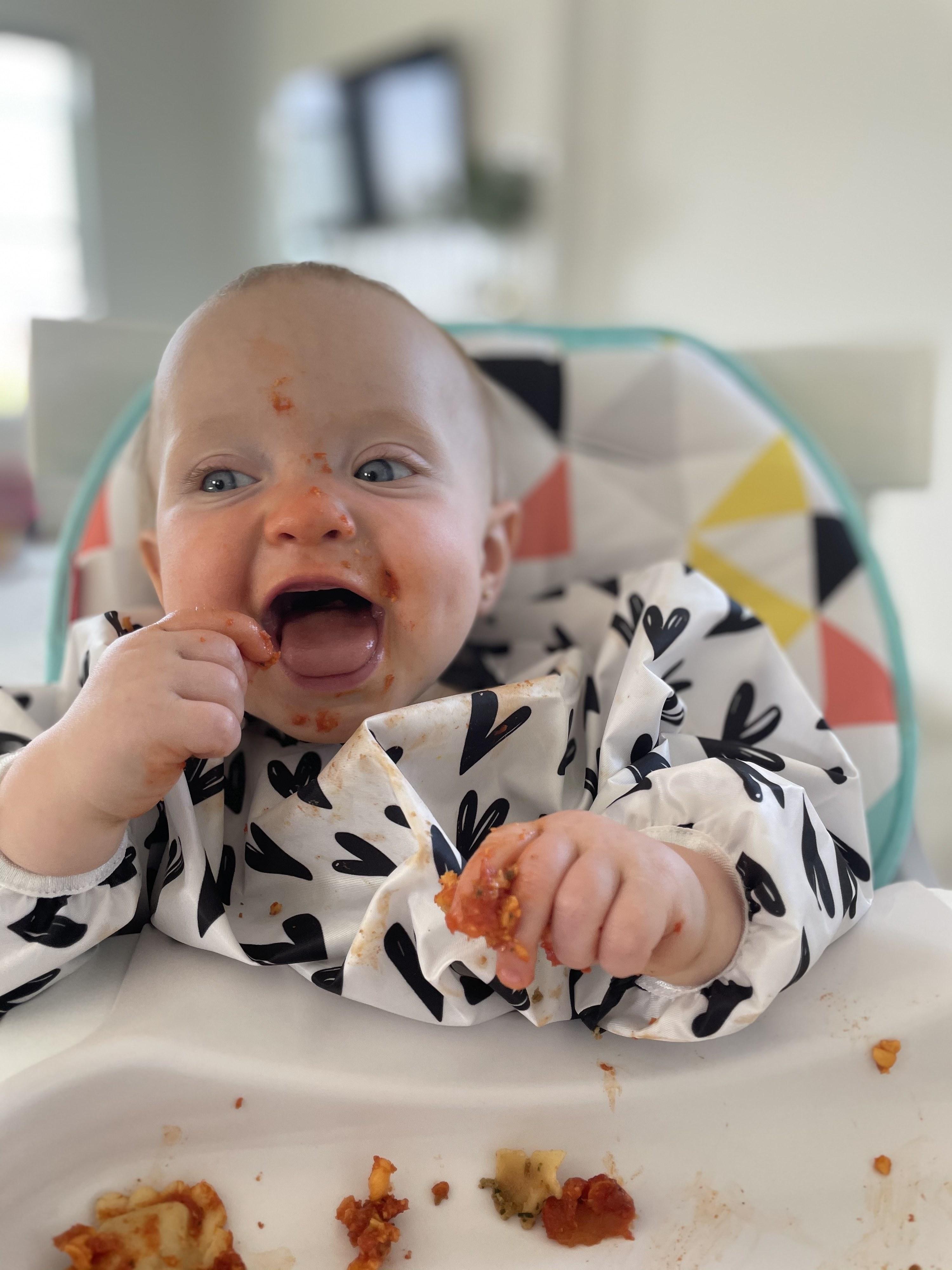 The author's youngest kid enjoying ravioli