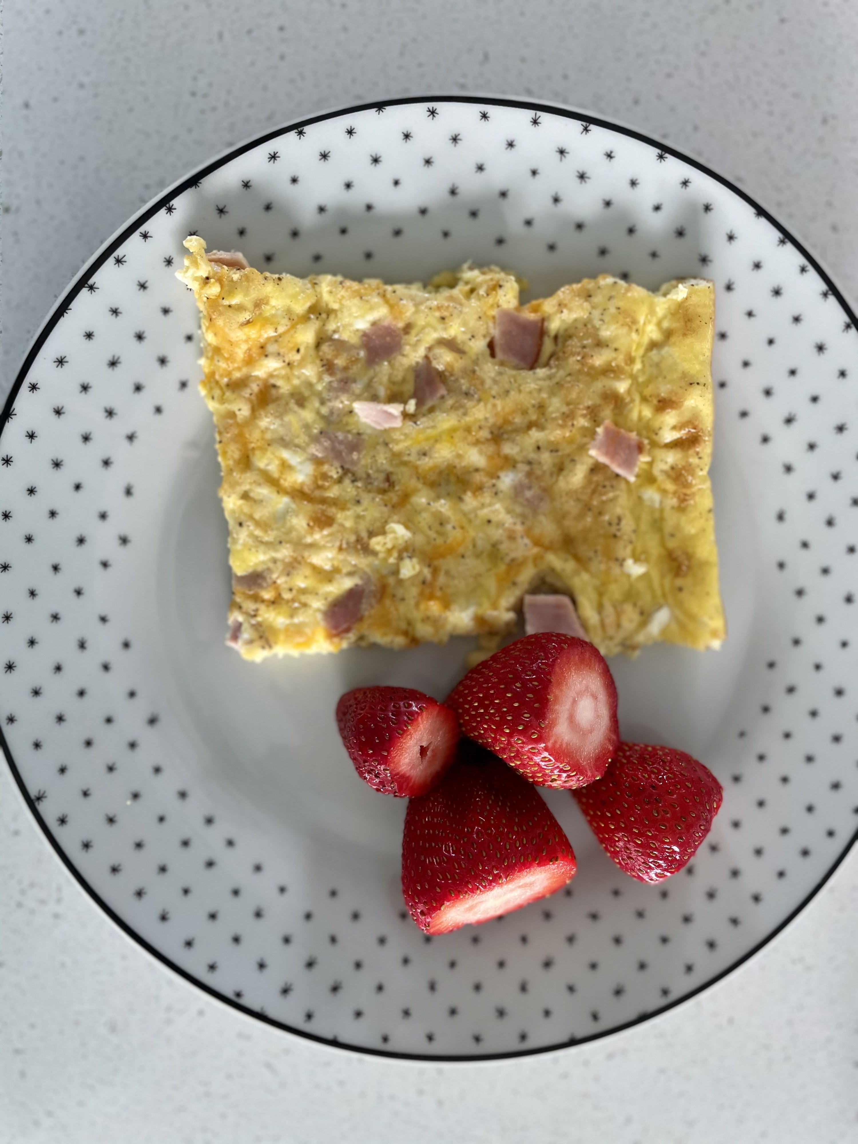 Sheet pan eggs plated with strawberries