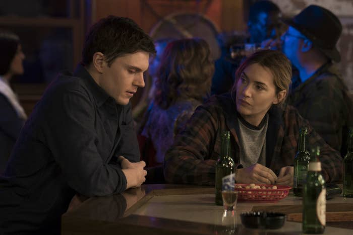 Evan Peters and Kate Winslet in a bar