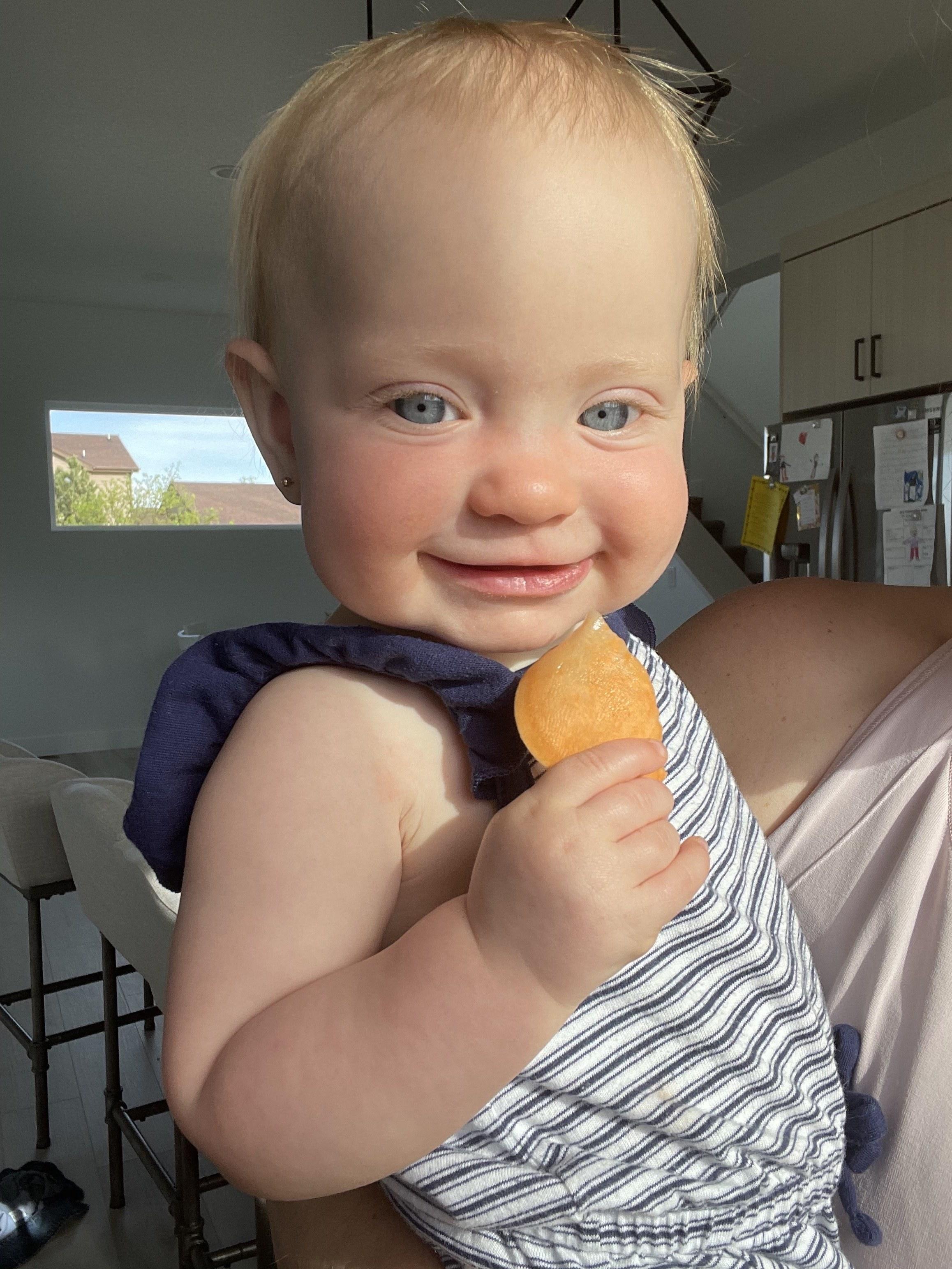 The author's youngest kid enjoying sweet potato fries