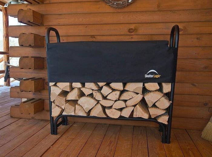the log rack filled with logs and a cover