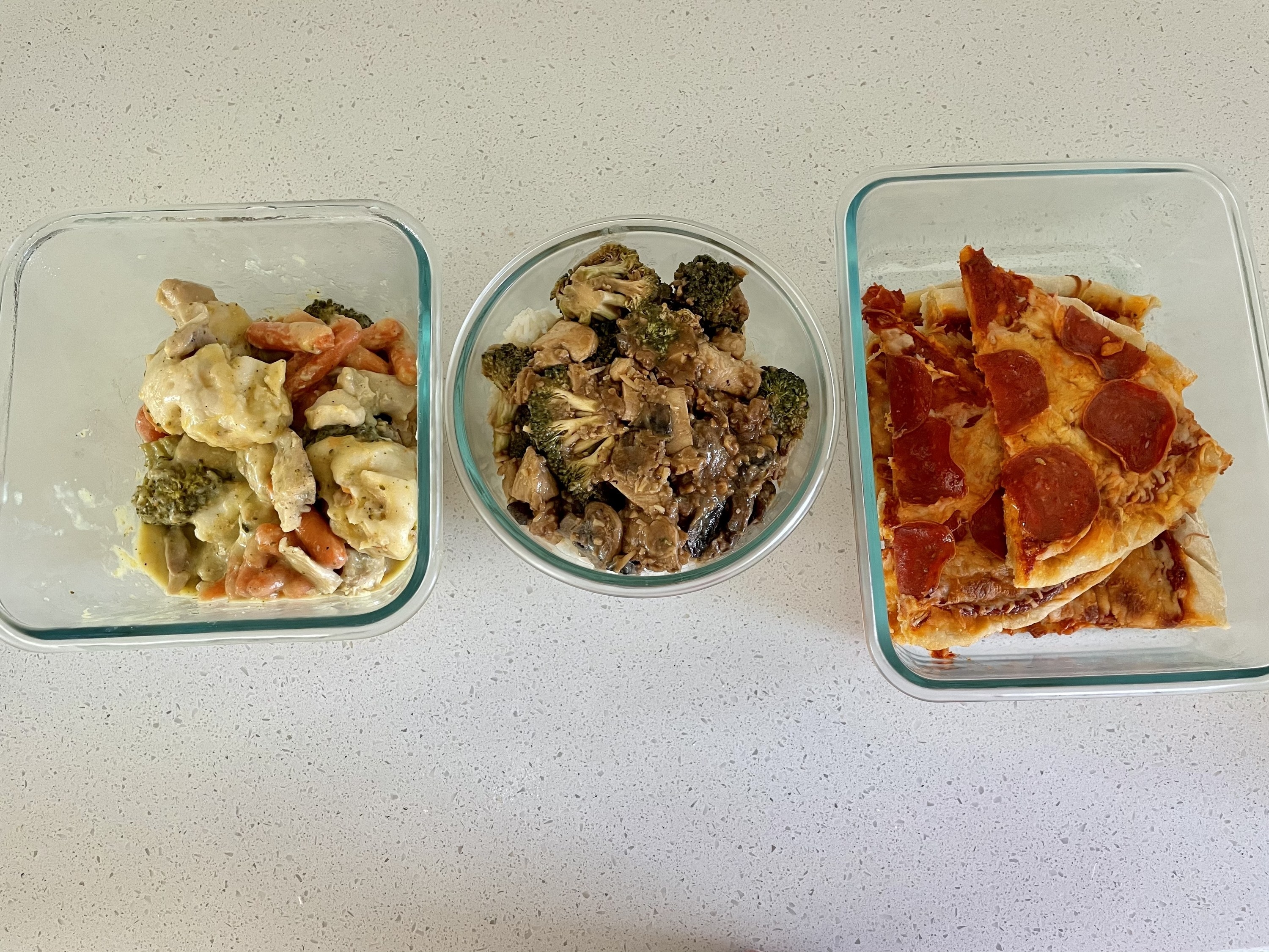 Three containers of leftovers: chicken, stirfry, and pizza