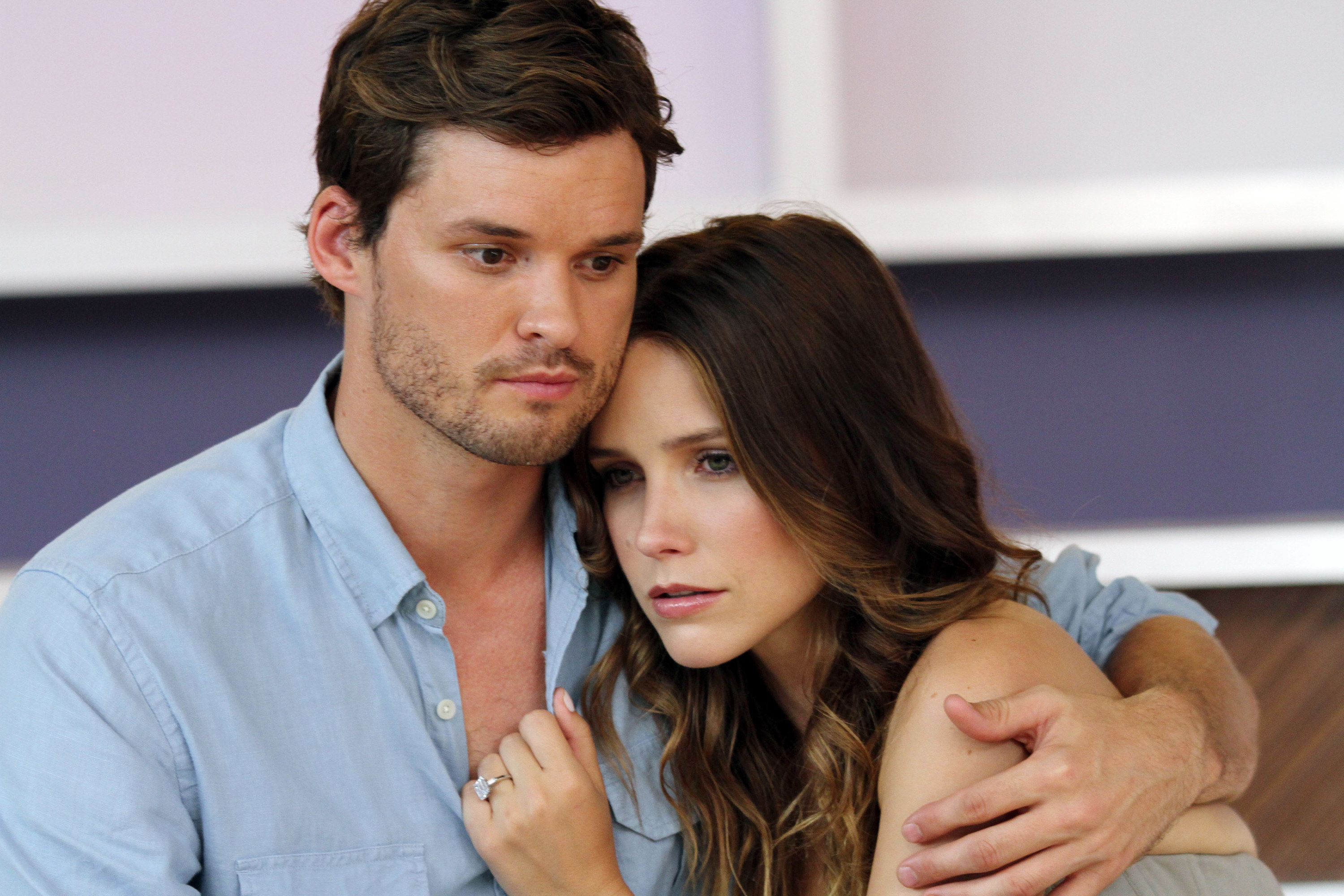 On the set of One Tree Hill, actor Austin Nichols holds a concerned-looking Sophia Bush