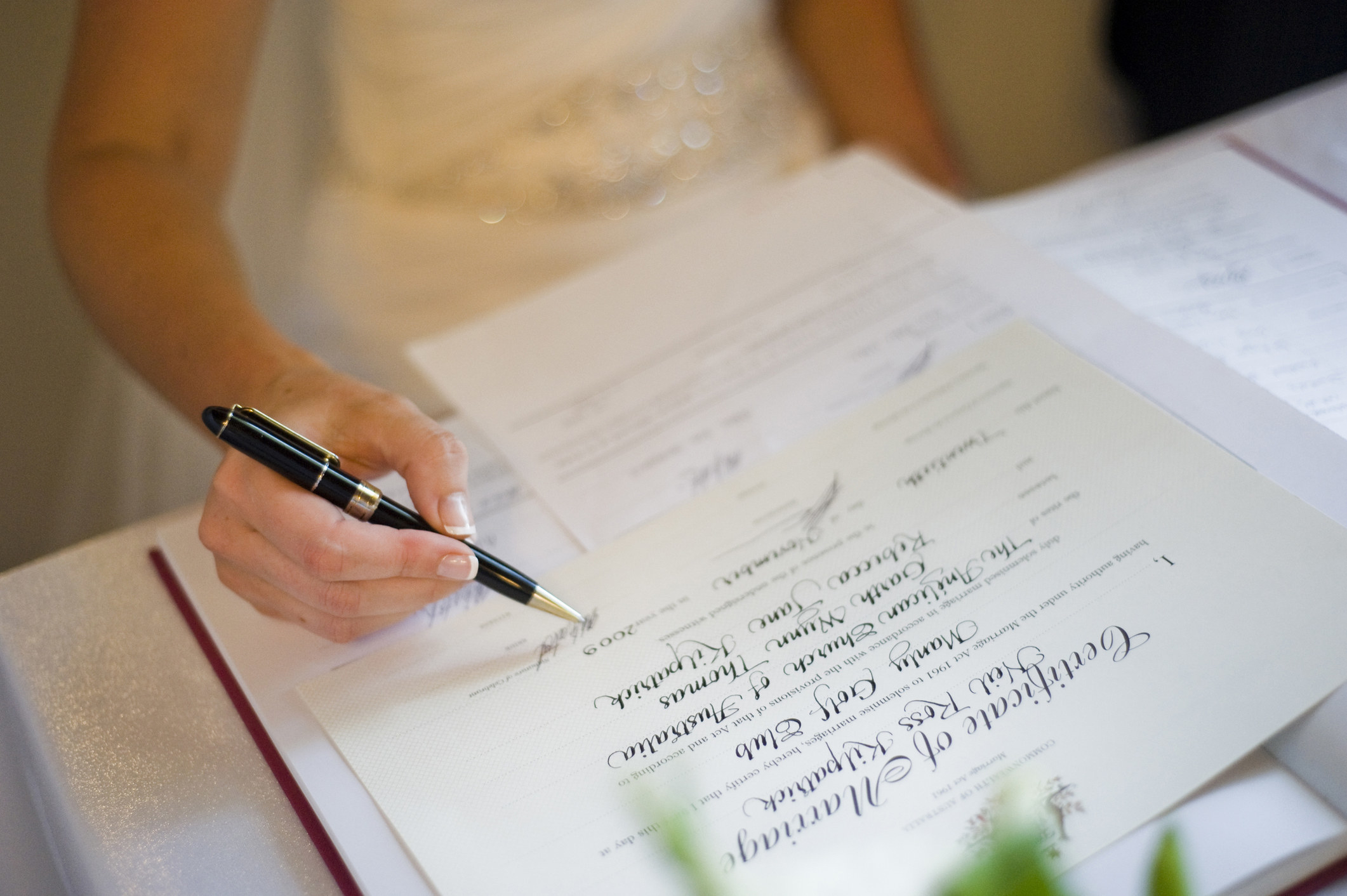 Someone signing a marriage certifercate