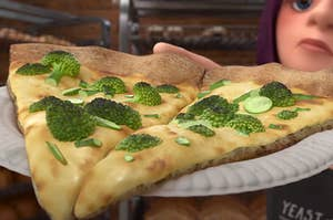 Two slices of pizza on a plate topped with broccoli