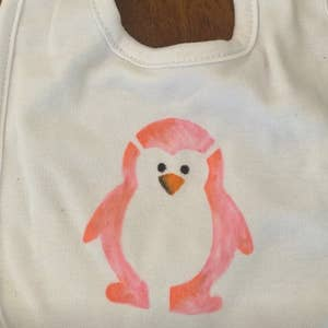 A bib with a drawing of a penguin