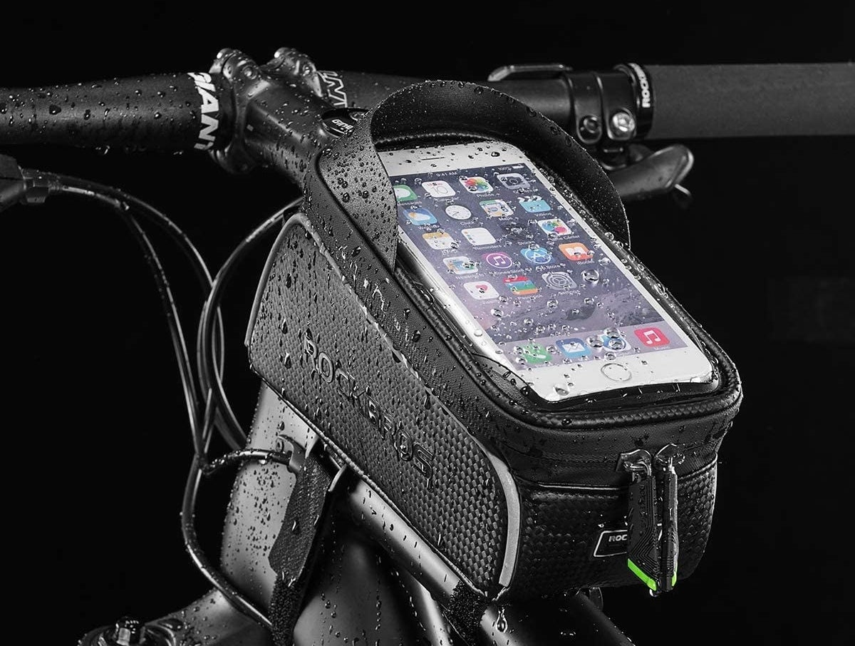 an iphone in the case on a bike  that's wet