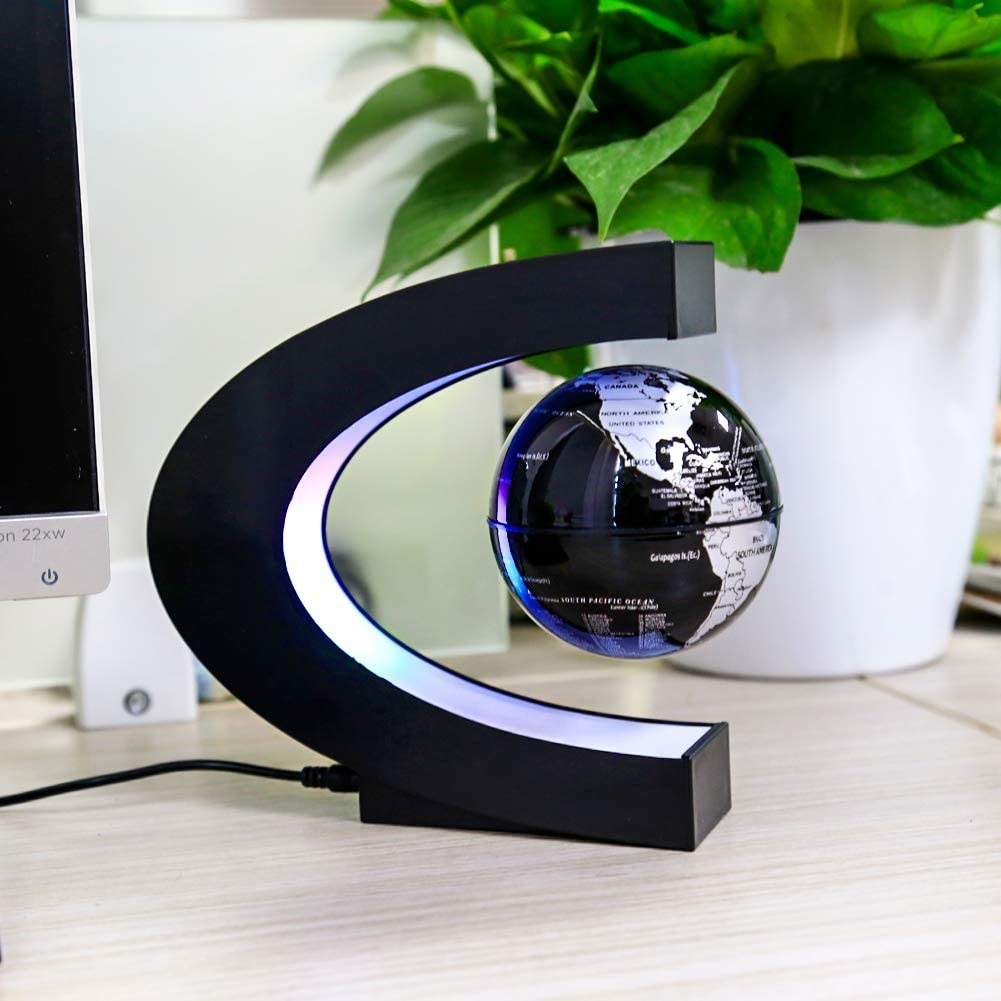 the globe in the magnetic base