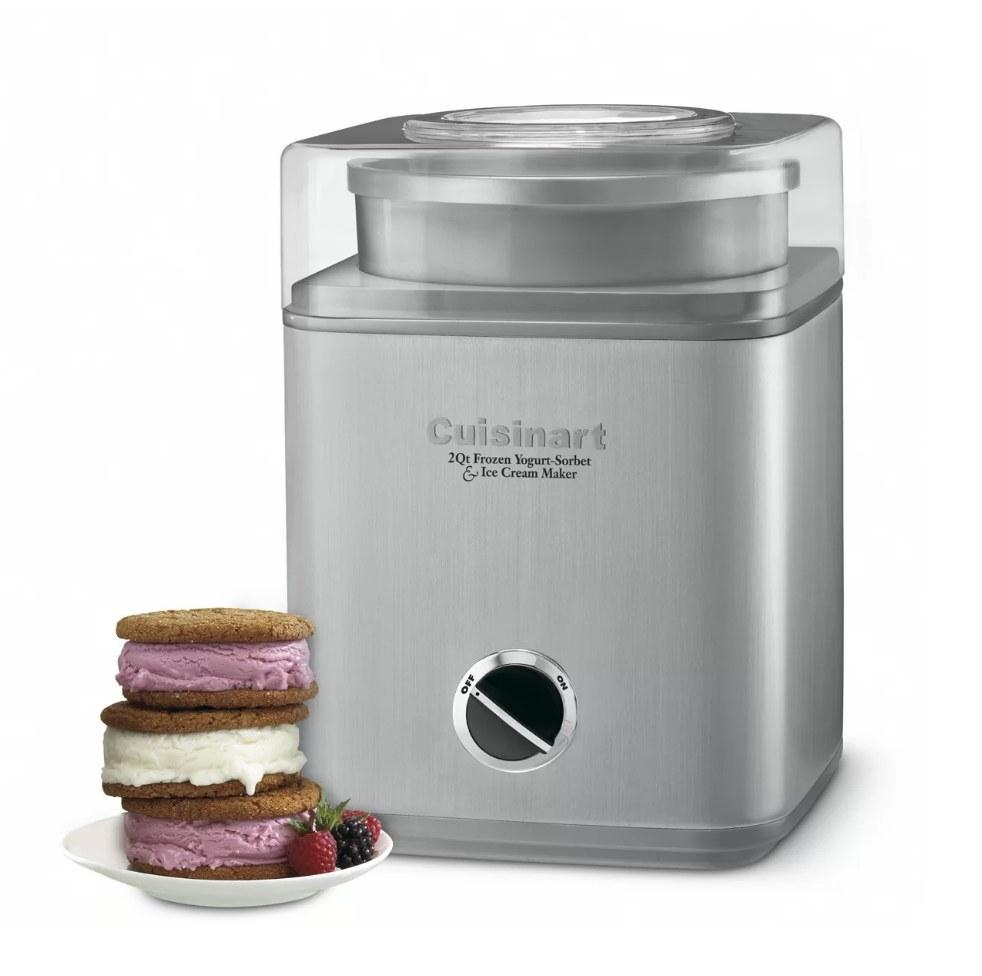 A silver, 20 quart, Cuisinart frozen yogurt and ice cream maker next to a plate of ice cream sandwiches