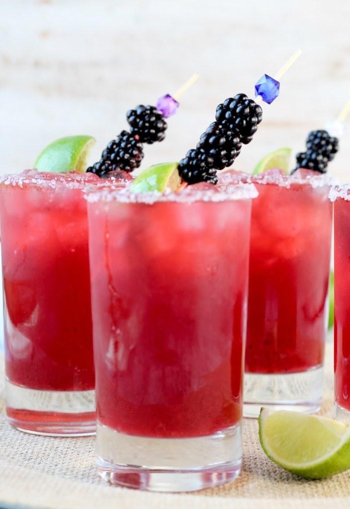 Blackberry margaritas topped with fresh berries.