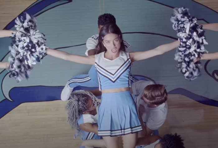 Olivia waving pom poms