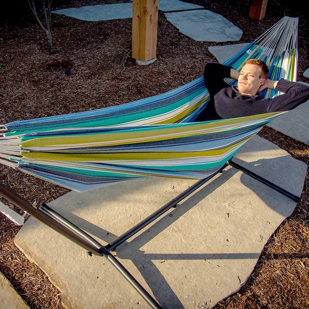 person lying in a hammock