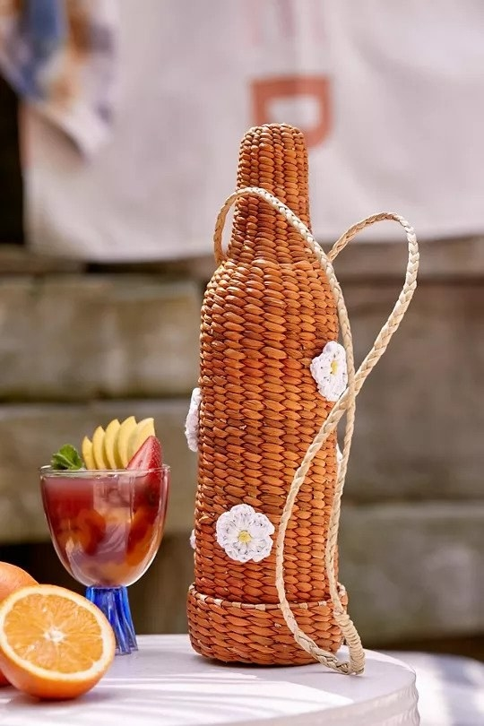 Wine shaped basket with a strap and floral details