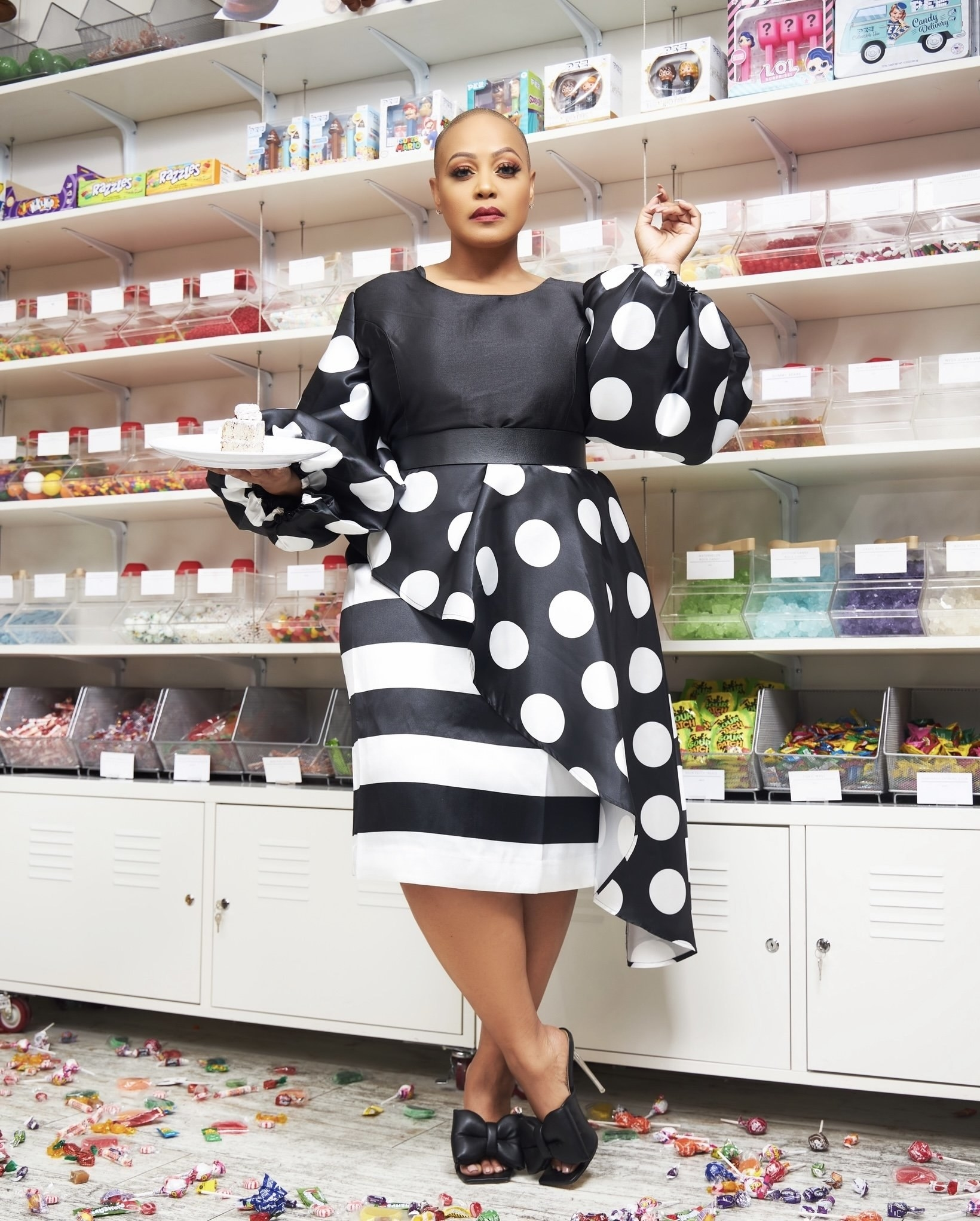 plus size model wearing a striped and polka dot dress