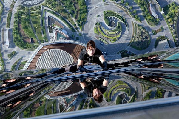 Tom Cruise climbing a skyscraper