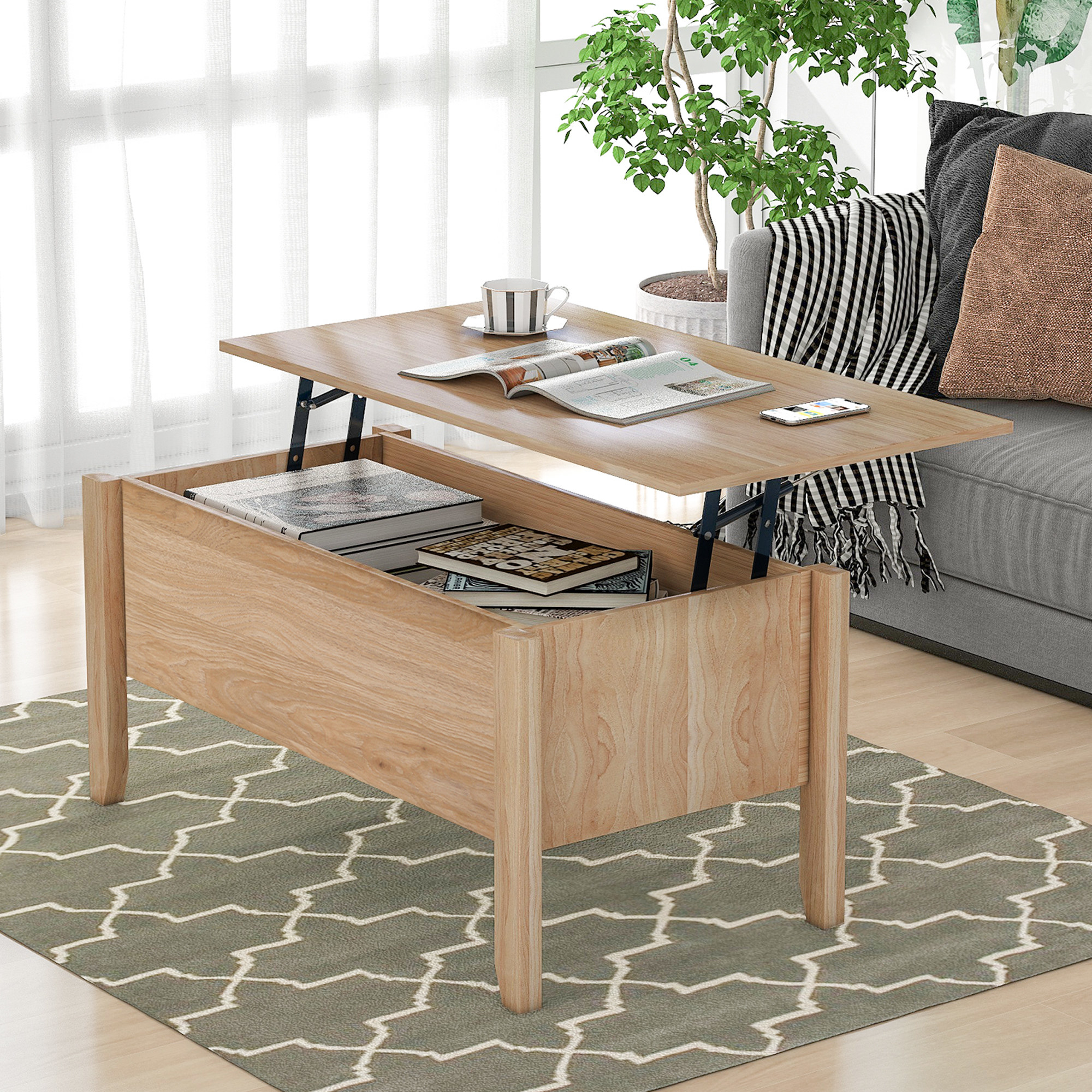 oak coffee table with a top that lifts and shifts over a lap to create a work desk. the coffee table is staged in a living room with a grey couch and grey area rug