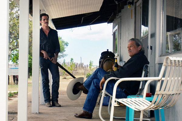 Chris Pine and Jeff Bridges talking on the porch