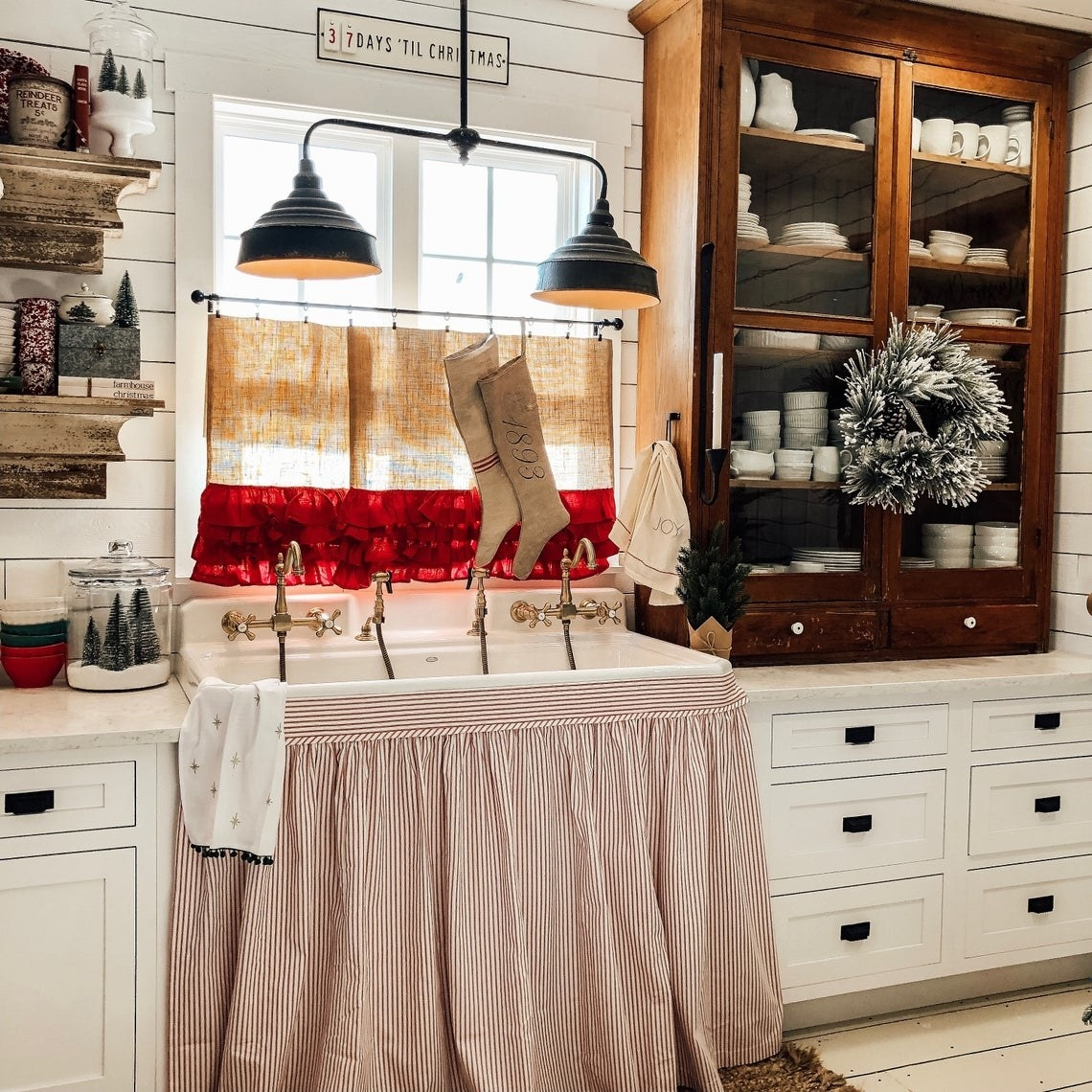 Red and white striped kitchen sink skirt in a festive kitchen